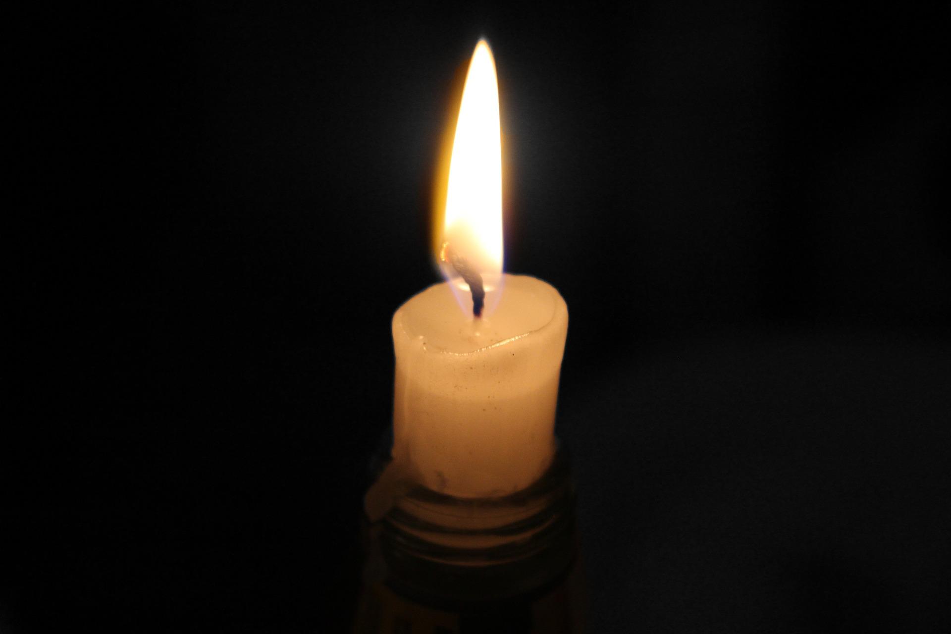 A burning candle.